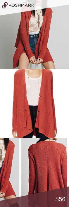 Free people cotton shark hem cardigan! Free people cotton shark hem cardigan in the color rust red. NWOT, never worn! Size medium. Oversized. Asymmetrical hem. Snap button up. Front pockets. So cute! Any questions lmk! Free People Sweaters Cardigans