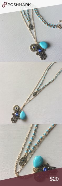 🆕Talk to the Hamsa Turquoise Evil Eye necklace 🆕Talk to the Hamsa necklace. Gold tone Hamsas + evil eye + double layered turquoise + gold plated chain. Make an offer or take advantage of my bundle discount! Ask me to create a custom bundle for even greater savings when buying 3+ items! 😘💗🐺 Jewelry Necklaces