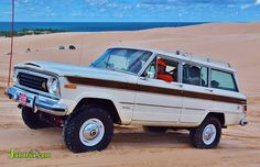 A clean vintage Jeep Wagoneer playing in the sand at Silver Lake ORV Park.  Bill Loomis photo credit.