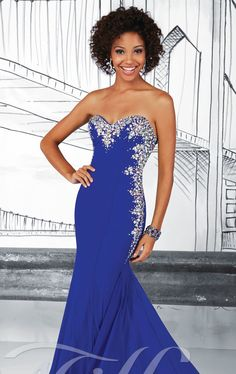 Look and feel like a hollywood star in Tiffany Designs 16017. This sassy evening gown features a strapless and sweetheart neckline. Sparkling beaded embellishments encrust the neckline and goes down the side bodice. Multitude cut-out detailing will you stand out. The mermaid shape shows off your figure.