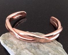 A personal favorite from my Etsy shop https://www.etsy.com/listing/231359550/copper-bracelet-br006-twisted-double-bar
