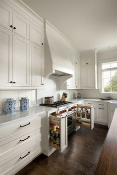 Custom cabinets make all the difference in your kitchen. Hidden spice racks and utensil storage help avoid clutter and keep your countertops clear. White Shaker Kitchen Cabinets, Kitchen Pantry Cabinets, Custom Kitchen Cabinets, Custom Kitchens, Spice Cabinets, Kitchen Stove, Rustic Kitchen, New Kitchen, Kitchen Ideas