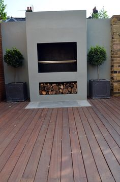 Modern Garden Design Artificial Grass Raised Beds Hardwood Decking Cedar Privacy Screen Bespoke Fireplace BBQ Balham Clapham Battersea Chelsea Fulham London Contact anewgarden for more information
