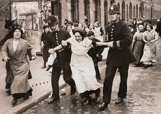 1915 London A woman involved in the anti Germany riots is led away