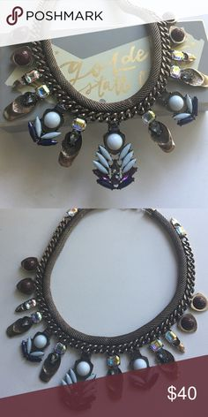 🆕Bronzed Goddess Collar Statement Necklace 🆕The Bronzed Goddess Collar Statement necklace. Bronzed chains encircled with blue + purple + brown + iridescent hued gems. This is THE statement necklace you need for fall. New with tags unattached. Make an offer or ask me to create a custom bundle for the best discount! 😘💗🐺 foxarazzi Jewelry Necklaces