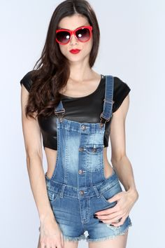 Throw on a casual tee under this stylish denim overall! Complete your casual look and add it to your wardrobe collection! Youll sure be eye catching when you step out in this trendy outfit! It features bleached, distressed, button up, front pockets, adjustable cross straps, front/back pockets, raw hem, and fitted. 98% Cotton 2% Spandex.
