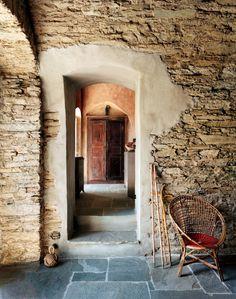 rough stone walls, slate floor, rustic decor