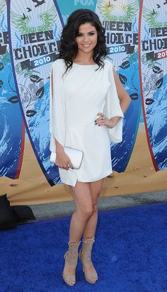 Looking radiant, Selena Gomez hit the 2010 Teen Choice Awards blue carpet in a sexy white slitted dress. via StyleList | http://aol.it/1vaG1vh