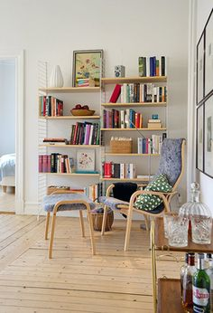 Shelves filled with books, birchandlittle.com we love this corner to sit and read. Quirky + quaint.