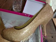 gold shoes which suzy found with hidden platform for £30