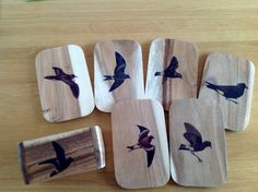 AI / A set of six personalized underlays. Bird motifs transferred on wood with gel medium.
