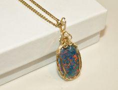 Wire Wrapped Opal Triplet Pendant by BaublesAndBijou on Etsy, $74.96