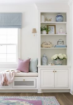 window seat styling and the prettiest built-in bookcases | Photography: Spacecrafting | Design: Bria Hammel Interiors  Read More: https://www.stylemepretty.com/living/2018/04/09/a-minneapolis-home-tour-that-beautifully-mixes-patterns/