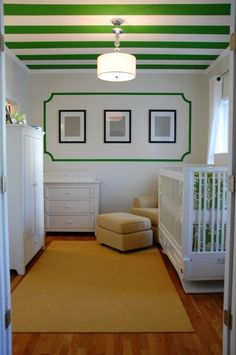 Green stripes on the ceiling of this Kate Spade-inspired nursery - LOVE!