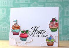 Baker's Dozen - a rainbow of cupcakes by Laura Bassen
