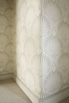 Farrow & Ball Lotus wallpaper BP2009 with skirting in Slipper Satin paint--Notice how the moulding is a different shade than the baseboard