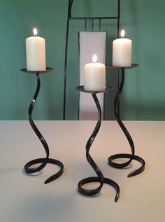 Low cost shipping worldwide!  This product has 3 guarantees: 1. I guarantee youll get a NEW and VALID product! 2. I guarantee youll get a HIGH QUALITY product for long-term use! 3. I guarantee youll get your MONEY BACK if the previous things are not so!  Set of 3 PCS. Wrought iron candlesticks, iron candle holders. HANDMADE - Hephaestus Crafts Coop. Croatia - EU.  Modern, minimalist and elegant iron home decoration, handmade candlesticks. This products is made in a traditional way, hammered…