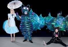 Smoke & Mirrors - A sculpted day dress with a blue petticoat induces a pure, almost hallucinogenic bliss. The Caterpillar guides the way, while Aly (the new name of Alice, played by Lois Chimimba, far right) holds the looking glass. Jenner wears a Dior Haute Couture silk gauze-and-organza dress.