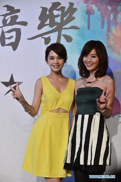 Singer Charlene Choi and Rainie Yang attend a press conference for the 17th China Music Awards (CMA) and Asian Influential Awards held in Macao, March 14, 2013. The CMA ceremony will be held on April 18, 2013. (Source: Xinhua)