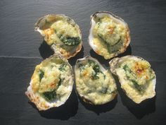 Oysters Rockefeller Recipe    2 tablespoons Olive Oil  1 tablespoons unsalted butter  2 Tablespoons Minced garlic  2 Tablespoons chopped shallots,  10 ounce package fresh spinach  Salt and pepper, to taste    1 cup Heavy Cream  1/4 cup Pernod  2 Dashes Tabasco Sauce    2 dozen oysters, on the half shell  1/3 cup Panko bread crumbs  1/4 cup grated Parmesan  2 tablespoon chopped parsley