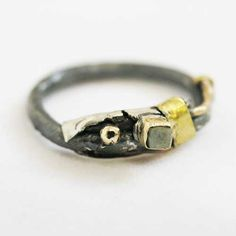 Precious Metals Ring  From Susannah Hanl's 'Arresting Collection'. Constructed from precious and semi precious metals. Silver, bronze, brass, copper & gold. Size R