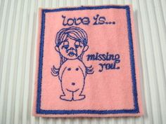 "creepy vintage patch.  ""love is missing you"" with anatomically odd crying cartoon girl."
