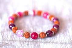 Rudraksha bracelet with pink natural Agate by MatahariSoulJewelry