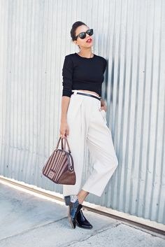 Blogger Style Me Grasie wears a black crop top, white belted trousers, patent leather oxfords, and a striped bowler bag
