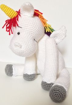 Starburst the Unicorn is a wonderfully colourful and bright take on the classic unicorn pattern. Finished product stands approximately 16.5 inches in height. Crochet rainbow amigurumi toy pattern.