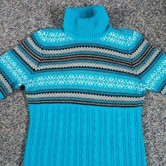 Dress Barn Sweater Light blue sweater with a fun fair isle design on the front and on the sleeves. Soft to the touch. Dress Barn Sweaters Cowl & Turtlenecks
