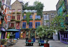 Neal's Yard in Camden, London surrounded by two- three-story stone buildings with gabled roofs & brightly painted window frames, is as inviting an outdoor gathering spot. It's a secret spot that you wouldn't know about unless you knew where to look. Find one of the two alleyways that lead into this former warehouse no-man's-land, & sit down for a rest amidst cafes, shops, plantings & whimsical public art. It is minutes away from a tube stop, but you'll feel miles away from the city.
