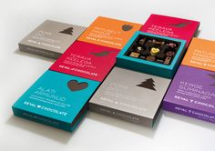 This chocolate box design uses a color-coding system in combination with a symbolic graphic for seasonal themed chocolates.  #packaging