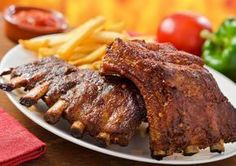 Pork back ribs are a great summer dinner. Pork Back Ribs Recipe from Grandmothers Kitchen. Pork Rind Recipes, Venison Recipes, Rib Recipes, Cooking Recipes, Pork Back Ribs, Bbq Ribs, Barbecue Grill, Barbecue Sauce, Dry Rub For Ribs