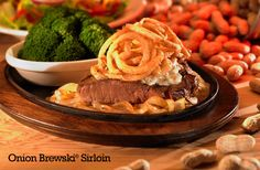 Logan's Roadhouse Onion Brewski Sirloin... Our signature 8-ounce USDA Choice Sirloin stacked on top of AmberBock beer-braised onions, smothered with garlic butter and topped with crispy onions.