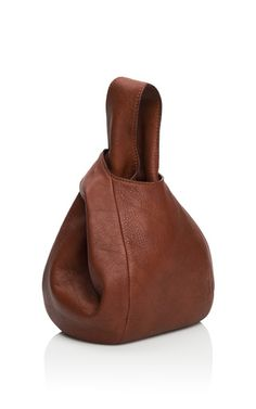 This deerskin leather pouch from J.W. Anderson features versatile top handles. 100% deer leatherLeather lined interiorMade in UKPlease note: This item is returnable for credit or full refund.