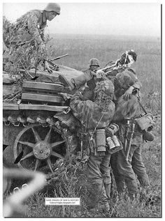 SS soldiers help a wounded comrade. Battle of Kursk. August 1943