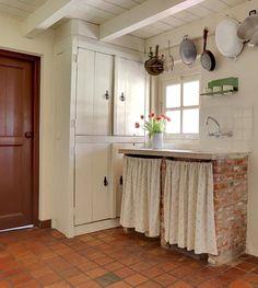 Rustic original built in cabinetry, beams, tile floor.