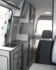 Interior of Peter's super-high-roof Sprinter camper van, showing the Reimo cabinetry.