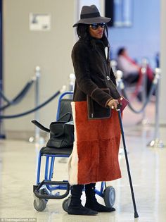 "After a ""light foot injury,"" Naomi Campbell was seen walking with a cane"