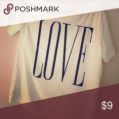 Short sleeved tee XL fits like medium/large Short sleeve white tee with LOVE graphic. Off the shoulder on right side. XL But fits more like a medium/large. Never worn. Tops Tees - Short Sleeve