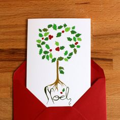 Holly Christmas card with red envelope illustrated by Serpentaires