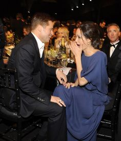 Brad Pitt and Angelina Jolie shared a laugh with a colleague during at the Screen Actors Guild Awards, 2009.