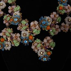 """<b>Exceptional and Early Miriam Haskell 4pc. Floral Parure; Collar necklace, brooch, bracelet, & clip earrings. horseshoe mark.</b> Minimal loss to beads. 15"""""""