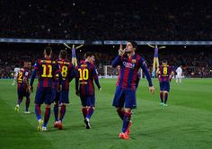 Luis Suarez of Barcelona (R) celebrates with team mates as he scores their second goal during the La Liga match between FC Barcelona and Real Madrid CF at Camp Nou on March 22, 2015 in Barcelona, Catalonia.