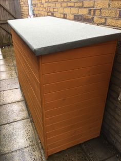 Garden Storage Box Comes With A Lift Up Lid And Separate Dividers