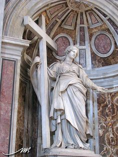 Statue of Saint Helena holding the True Cross and nails    Location: Saint Peter's Basilica, Vatican City, Italy