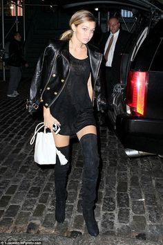 Gigi Hadid wearing Balmain x H&M Jacket, H&M x Balmain Boots and Balmain x H&M Tank