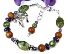 Hey, I found this really awesome Etsy listing at https://www.etsy.com/listing/244158316/horse-charm-bracelet-adjustable-green
