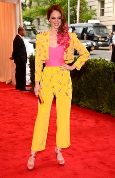 Coco Rocha in a vintage Givenchy yellow jumpsuit, accessorised with a Kotur gold clutch and new pink hair - tendance Jaune