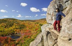 Woman climbing The Beehive, Acadia National Park, Maine (© Ken Brown/Getty Images)